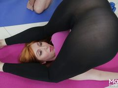 busty redheaded milf seduces her yoga instructor